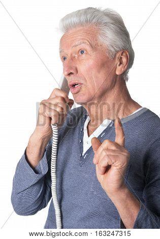 Portrait of senior man talking on the phone isolated on white background