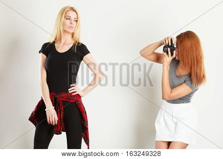 Mulatto Girl Photographing Blonde Woman