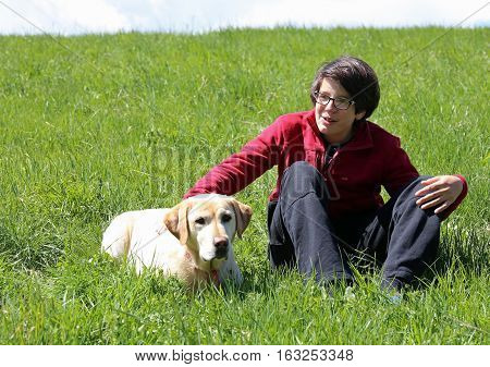 Smiling Young Guy With His Yellow Labrador Retriever Dog