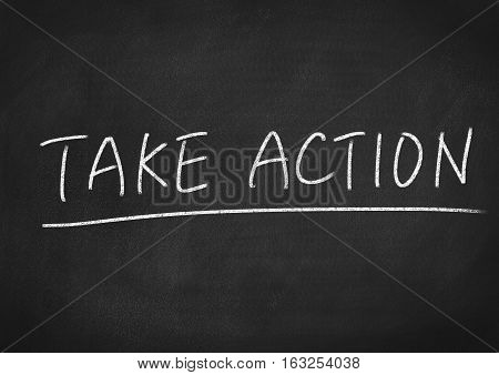 take action concept word on blackboard background
