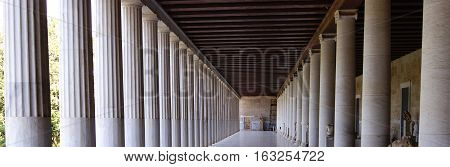 Colonnade of an ancient museum, Stoa of Attalos, The Ancient Agora, Greece, Athens. Widescreen