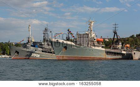 Sevastopol, Russia - June 09, 2016: Average sea tanker Koida and Rescue vessel Epron in the Bay of Black Sea.