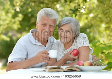 mature couple have a rest in the garden