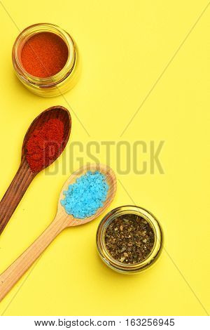 Spices In Spoons With Jars