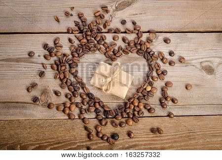 Frame- Heart From Coffee Beans And Small Parcel Inside It