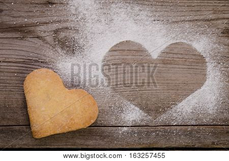 Mark In Shape Of Heart With Powdered Sugar And Cookie