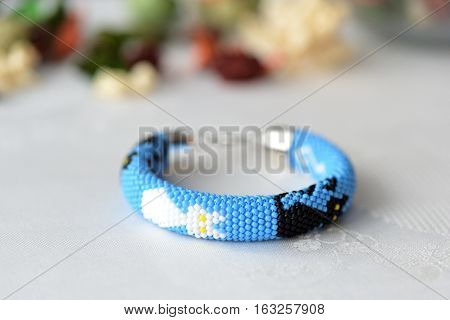 Blue Beaded Bracelet With The Image Of Black And White Cats