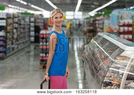 Salesman Helping Beautiful Woman To Choose