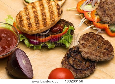 cooking hamburger with vegetables and minced meat