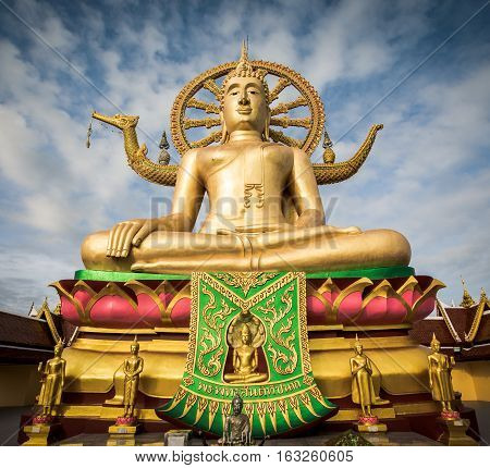 Big Buddha statue at Wat Phra Yai temple with blue sky in the morning on Koh Samui Suratthani Thailand