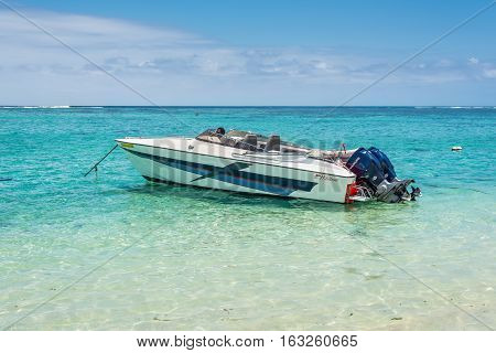 Le Morne Mauritius - December 7 2015: Speed boat waiting tourists on the Le Morne Beach one of the finest beaches in Mauritius and the site of many tourism facilities.