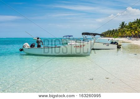 Le Morne Mauritius - December 7 2015: Fishing boats on the Le Morne Beach one of the finest beaches in Mauritius and the site of many tourism facilities.