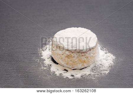 a delicious christmas cookie with powdered sugar