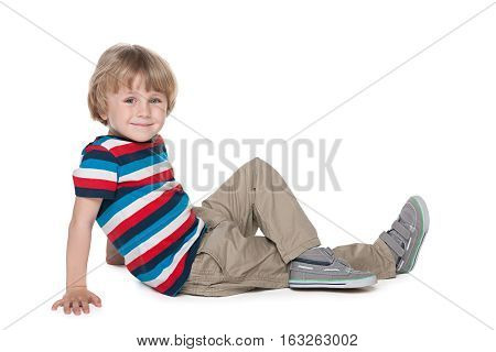 Blond Boy Sits On The Floor