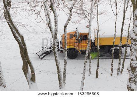 Gomel Belarus - DECEMBER 25 2016 snowblower cleans track city park