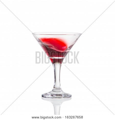 red wine swirling in a goblet martini glass isolated on a white background