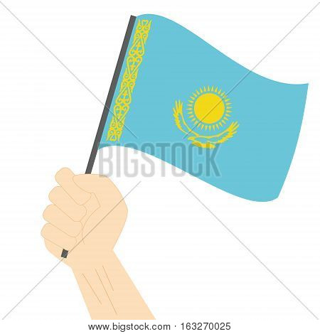 Hand holding and raising the national flag of Kazakhstan