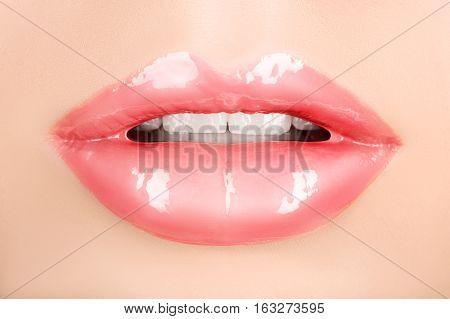 beautiful female lips with orange colored macro close-up