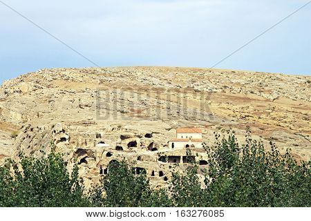 Stone city - Uplistsikhe, Georgia. It is an ancient rock-hewn town in eastern Georgia, some 10 kilometers east of the town of Gori, Shida Kartli