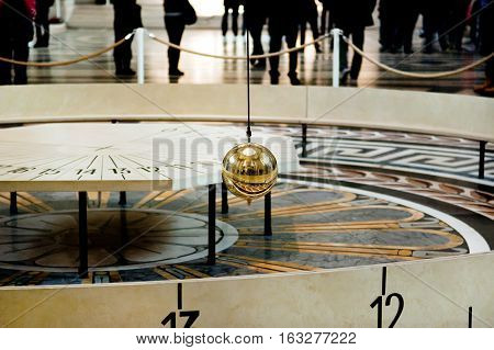 Paris France - November 4 2012: Foucault pendulum at Pantheon. The pendulum was installed in 1851 to demonstrate the rotation of the Earth.