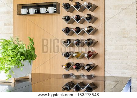 Bright kitchen interior with bottles of wine