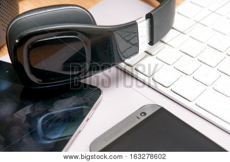 Communication technology equipment still life of phone keyboard tablet and headphones