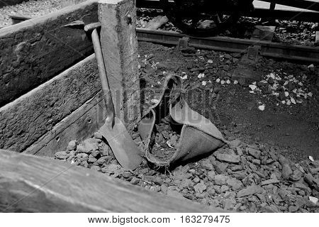 A Coal Sack and Shovel at a Vintage Railway Sidings.