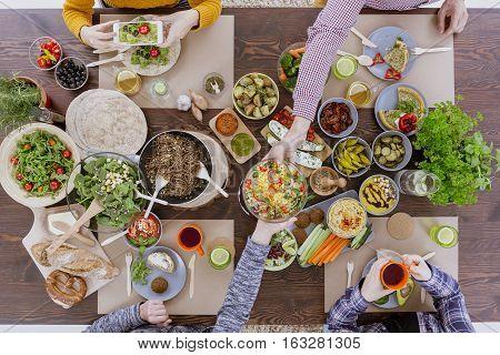 Friends Having Vegetarian Feast