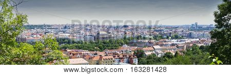 View of Prague on a summer day from Petrin Tower. Czech Republic. Panoramic photo