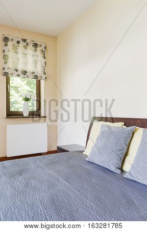 Double Bed With Blue Bedspread