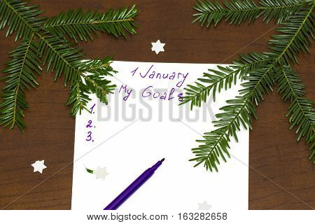 Purple Pen And Notepad For Writing Resolutions And Goals For The New Year,  Branches Of A Christmas