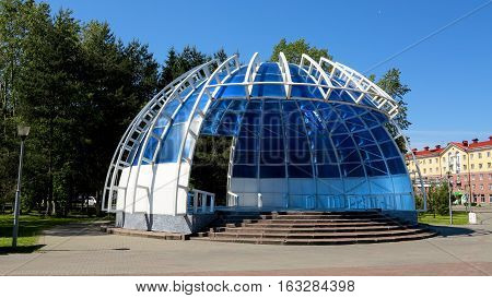 a semicircular building for community events summer blue sky