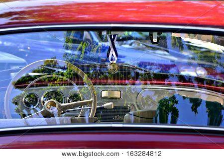 TÂRGU MUREȘ, ROMANIA - September 24th, 2016: Restored classic red Skoda Octavia interior shot through rear window