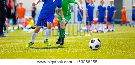 Kids Playing a Soccer Game. Young Boys Kicking Football Soccer Match on Grass Pitch. Soccer Games For Kids. Young Players Running and Kicking Ball