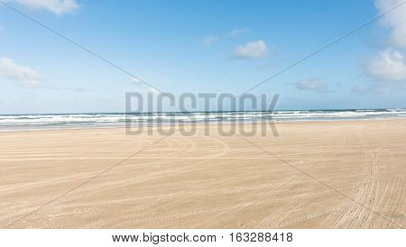 Driving on the beach along the Pacific Ocean on Fraser Island in Queensland, Australia