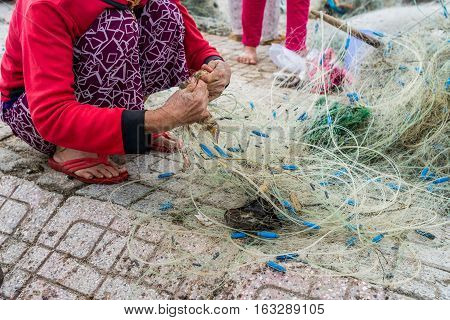 Hands Of The Old Fisherman Untangles Fishing Nets, Nha Trang