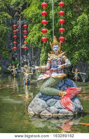 PHUKET THAILAND - CIRCA MAR 2015: Mythological characters adorn the artificial pond In Thailand