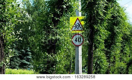 road sign steep on a summer day