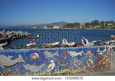CONCON, CHILE - NOVEMBER 28, 2016: Colourful fishing boats on Pacific Coast of Chile at Concon.