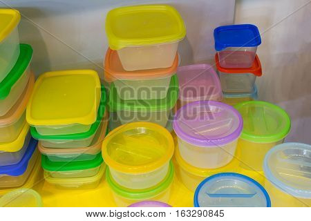 Reusable plastic container on the counter of the store