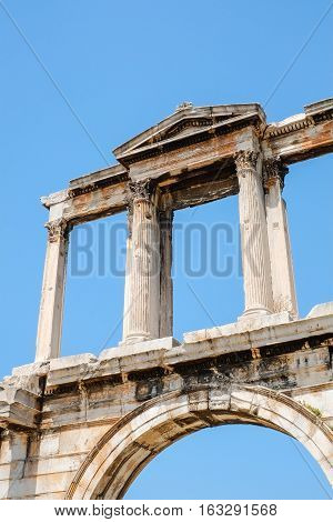 Looking up view of famous Greek temple pillars against clear blue sky in Temple of Zeus Greece