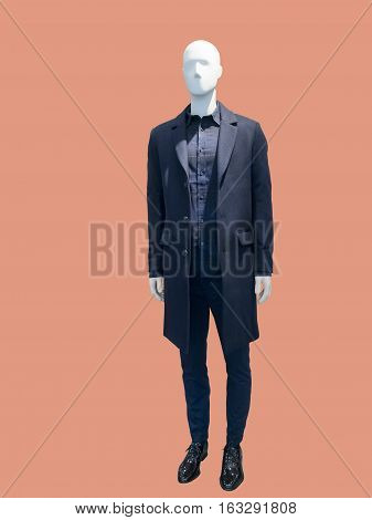Full-length male mannequin wearing black coat isolated. No brand names or copyright objects.