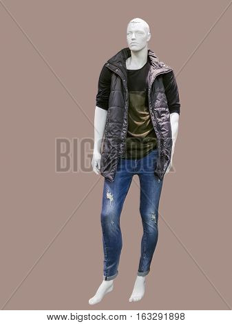 Full length male mannequin dressed in sleeveless jacket shirt and blue jeans isolated. No brand names or copyright objects.