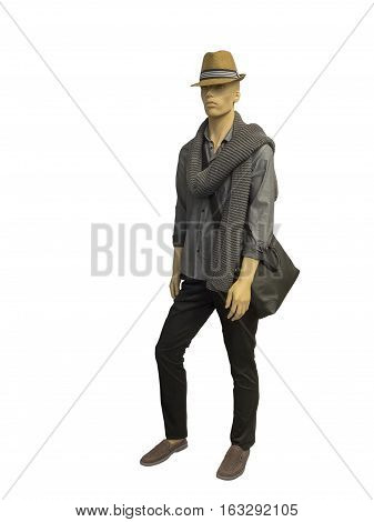 Full-length male mannequin dressed in gray shirt and trousers isolated on white background. No brand names or copyright objects.