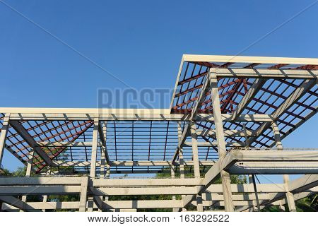 Close-up Of Roof Construction Home Framing Against Blue Sky