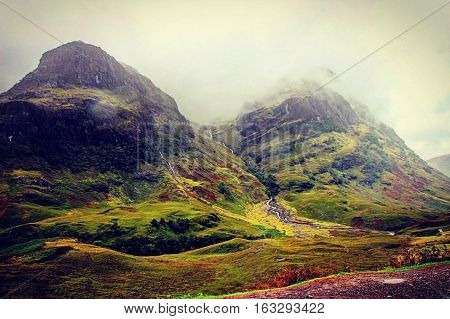 Glencoe traveling through the Scottish highlands on misty day