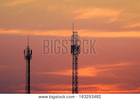 Silhouette Telecommunication Tower At Sunset.