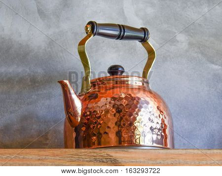 Old Fashioned Copper Kettle On Shelf.