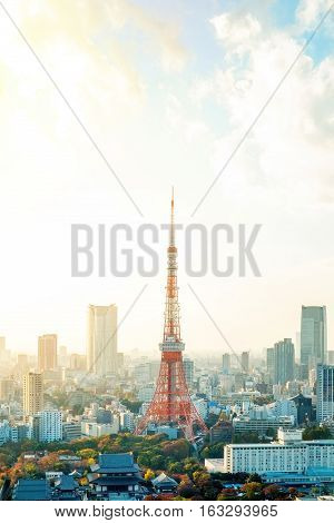 Business concept for real estate and corporate construction - Tokyo tower landmark of Japan and panoramic modern city bird eye view with dramatic sunrise and morning sky