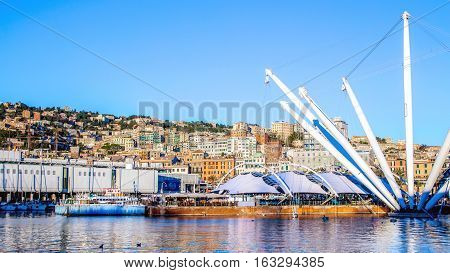 The port of Genoa with the cityscape in the background Italy